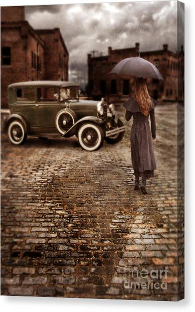 Woman With Umbrella By Vintage Car Canvas Print