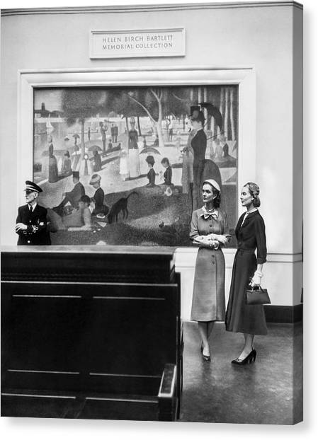 Women View Seurat Painting In Museum Canvas Print by Horst P Horst