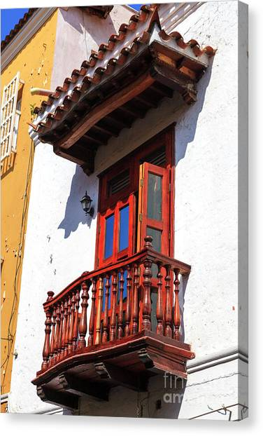 Wood Balcony In Cartagena Canvas Print by John Rizzuto