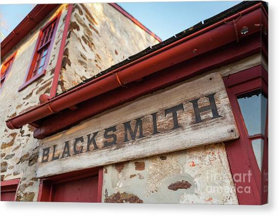 Wood Blacksmith Sign On Building Canvas Print