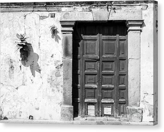 Canvas Print featuring the photograph Wooden Door Antigua Guatemala Black And White by Tim Hester