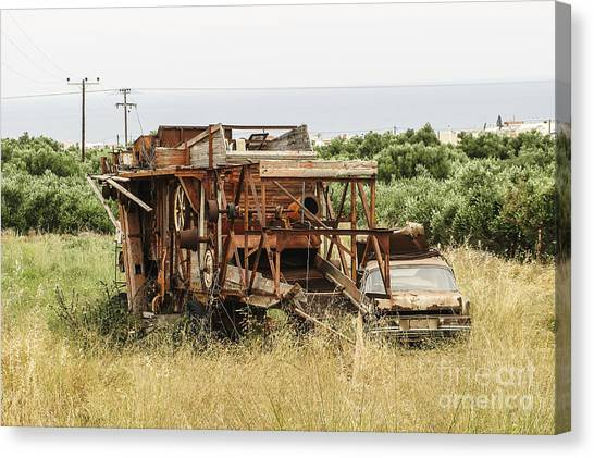 Worn Out Harvester And Car Canvas Print by Kim Lessel