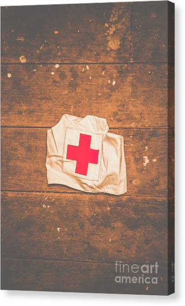 Health Care Canvas Print - Ww2 Nurse Cap Lying On Wooden Floor by Jorgo Photography - Wall Art Gallery