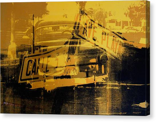 Street Signs Canvas Print - Yellow Car And Street Sign by David Studwell