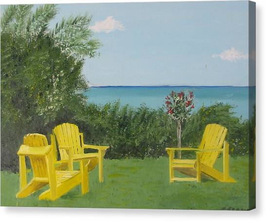 Yellow Chairs At Blue Mountain Beach Canvas Print by John Terry