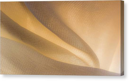 Canvas Print featuring the photograph Yellow Flow Of Fabric by Yogendra Joshi