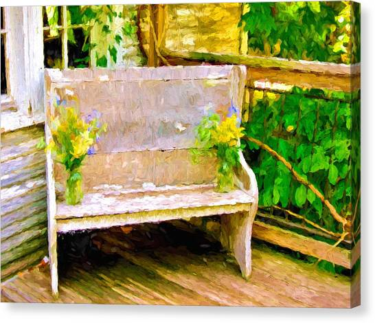 Yellow Flowers On Porch Bench Canvas Print