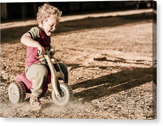Dirt Bikes Canvas Print - Young Boy Breaking At Fast Pace On Toy Bike by Jorgo Photography - Wall Art Gallery