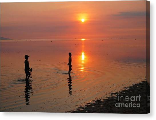 Young Fishermen At Sunset Canvas Print