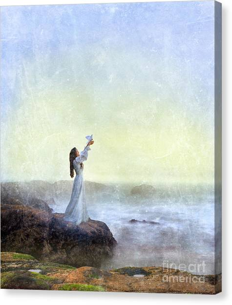 Young Lady Releasing A Dove By The Sea Canvas Print