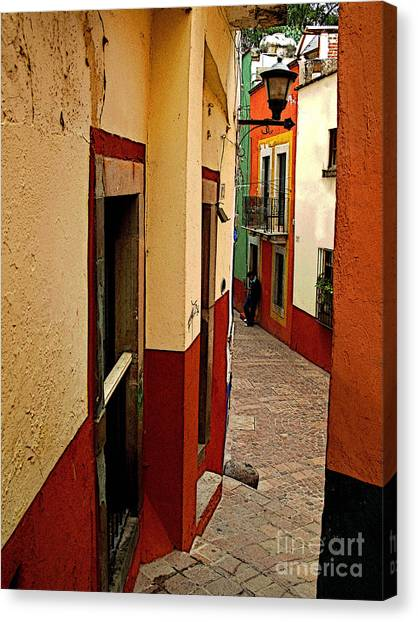 Young Man In The Alley Canvas Print by Mexicolors Art Photography