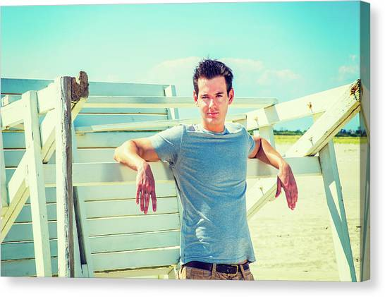 Young Man Relaxing On The Beach Canvas Print