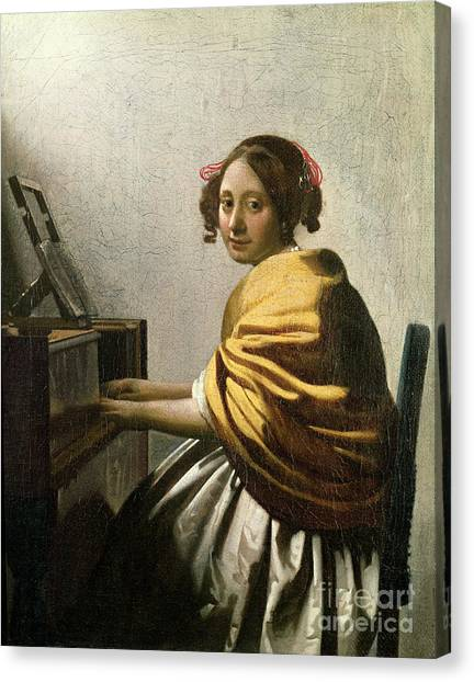 Harpsichords Canvas Print - Young Woman At A Virginal by Jan Vermeer