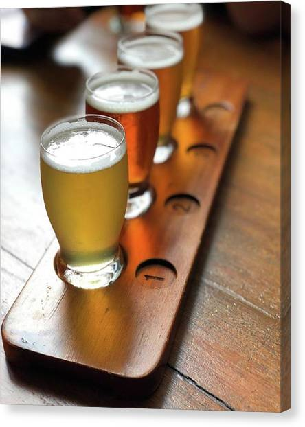 Your Choice Of Four Draft Beers From Canvas Print by Arya Swadharma
