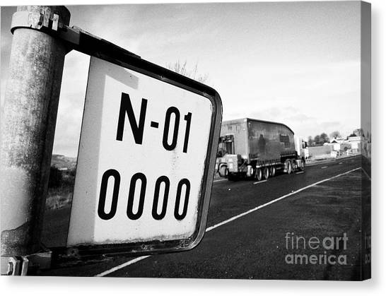Brexit Canvas Print - zero miles marker start of the N1 on the irish border between Northern Ireland and Republic of Irela by Joe Fox