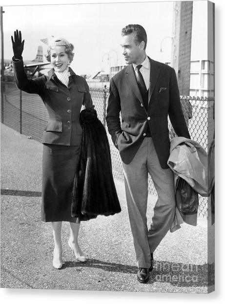 Zsa Zsa Gabor And Porfirio Rubirosa Arrive At Idlewild Airport From Ireland. 1954 Canvas Print by Barney Stein