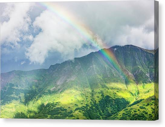 A Rainbow Shines Through Atmospheric Canvas Print by Kevin G. Smith