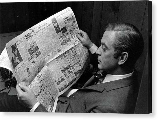 Actor Michael Caine Reading A Newspaper Canvas Print