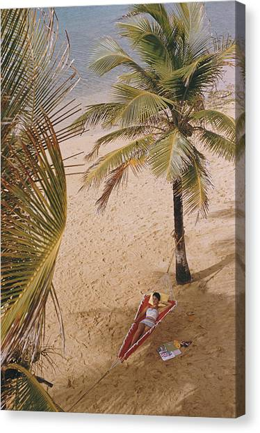 Caribe Hilton Beach Canvas Print by Slim Aarons