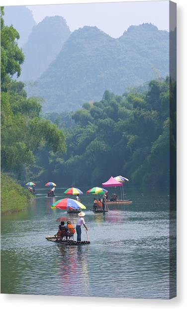 Chinese Tourists In Bamboo Raft At Canvas Print