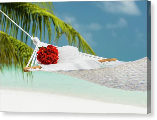 Hammock With Flowers And Hat On A Canvas Print