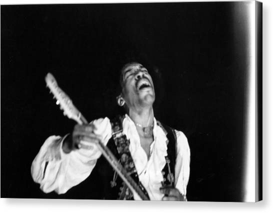 Jimi Hendrix Performs At Monterey Canvas Print by Michael Ochs Archives