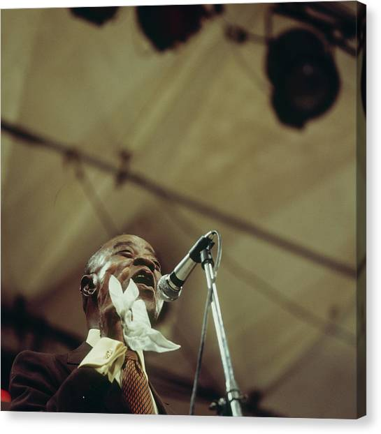 Louis Armstrong On Stage At Newport Canvas Print by David Redfern