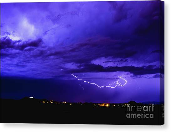 Rays In A Night Storm With Light And Clouds. Canvas Print