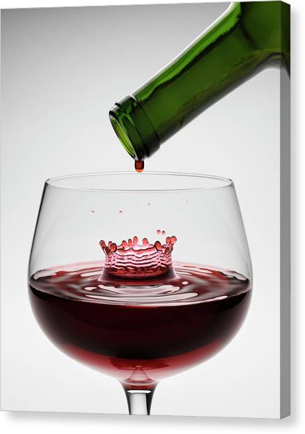 Red Wine Being Poured Into Wineglass Canvas Print