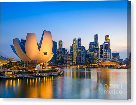 Singapore Skyline At The Marina During Canvas Print by Sean Pavone