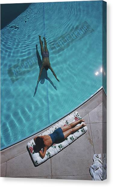 Swimmer And Sunbather Canvas Print