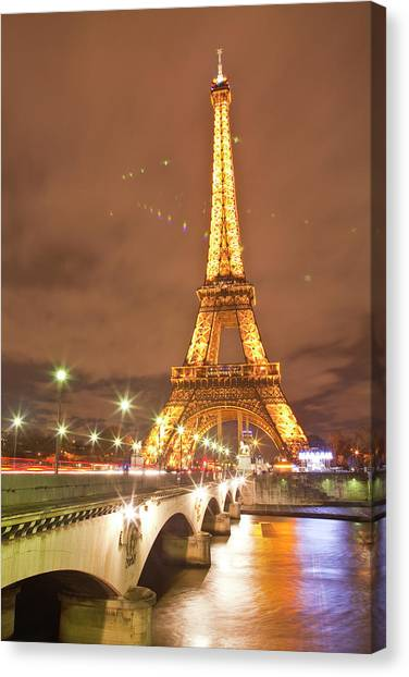 The Eiffel Tower Lit Up At Night In Canvas Print