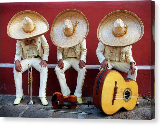 San Miguel De Allende Canvas Print - Three Mariachis On An Orange Wall by Holly Wilmeth