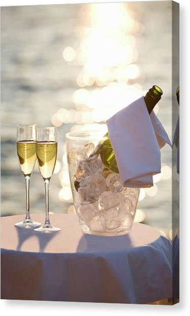 Two Glasses Of Champagne At Sunset Canvas Print