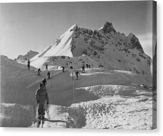 Uphill Skiers Canvas Print by Bert Hardy