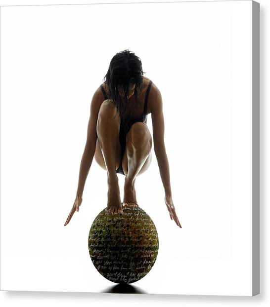 Woman Balancing On Globe Canvas Print by Alfonse Pagano