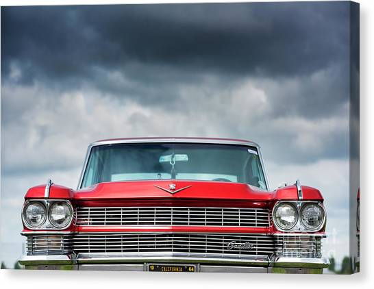 Rainclouds Canvas Print - 1964 Cadillac Coupe Deville by Tim Gainey