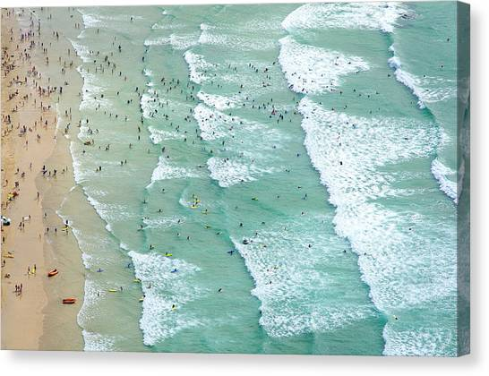 Swimmers And Surfers On Beach, Aerial Canvas Print