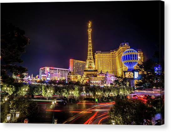 Canvas Print featuring the photograph Nigh Life And City Skyline In Las Vegas Nevada by Alex Grichenko