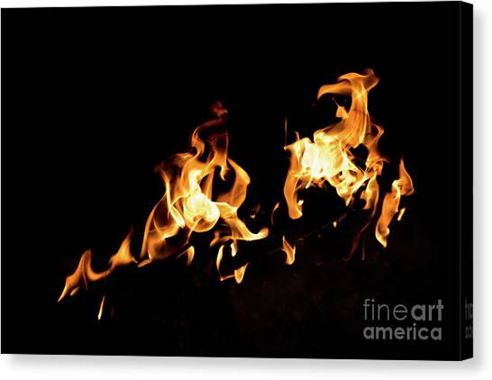 Flames In The Fire Of A Red And Yellow Barbecue. Canvas Print