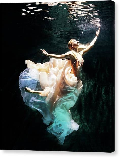 Female Dancer Performing Under Water Canvas Print by Henrik Sorensen