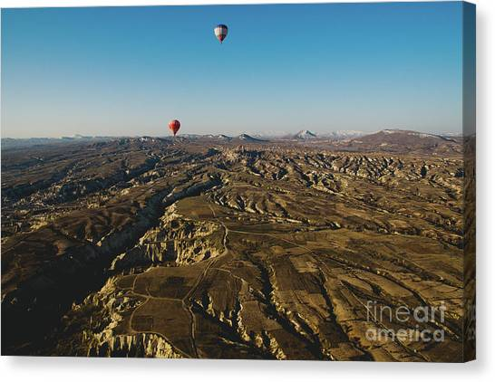 Colorful Balloons Flying Over Mountains And With Blue Sky Canvas Print