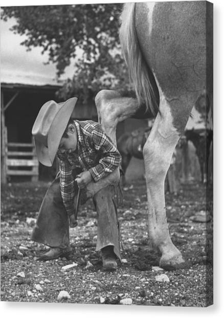 6 Yr. Old Cowboy Learning How To Shoe A Canvas Print