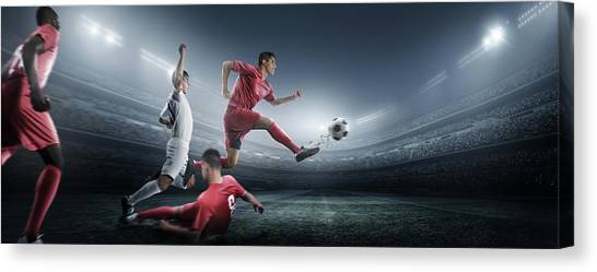 Soccer Player Kicking Ball In Stadium Canvas Print by Dmytro Aksonov