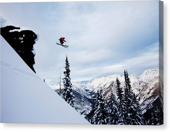 A Athletic Skier Jumping Off A Cliff In Canvas Print