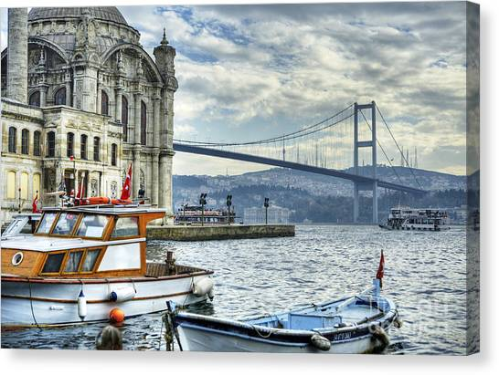 A Beautiful View Of Ortakoy Mosque And Canvas Print by Senai Aksoy