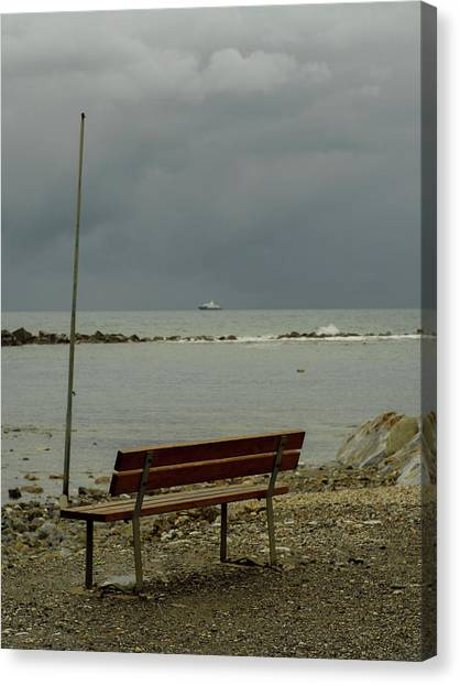 A Bench On Which To Expect, By The Sea Canvas Print