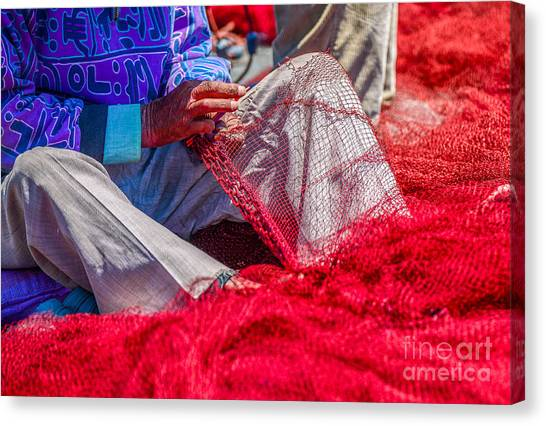A Closeup To Fishermans Hands Sewing Canvas Print by Pixinoo