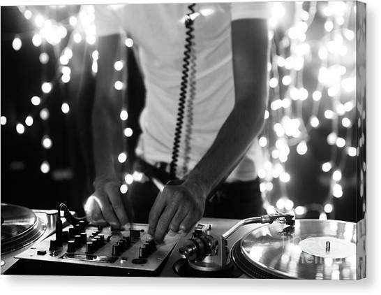 A Cool Male Dj On The Turntables Canvas Print by Dubassy