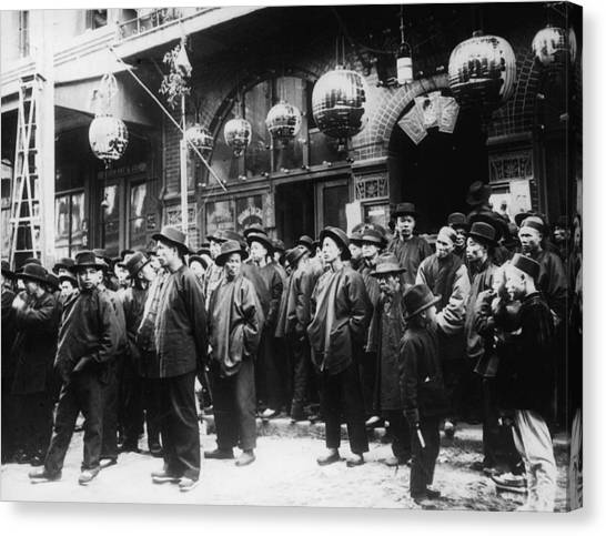 A Crowd Of Men On The Street In Canvas Print by Fpg